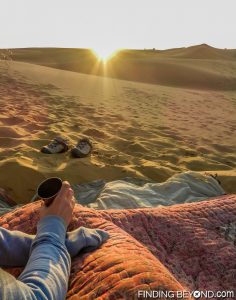 Shelley enjoying her chai tea as she watches the sun rise in the Thar Desert, India