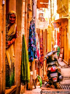 Elderly woman at her Jaisalmer Fort home doorway