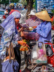 Local women buying Lychee in Vietnam.