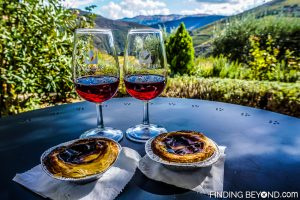 Enjoying local port wine and traditional Portuguese tarts from our room. Our guide to the Douro Valley, Portugal.