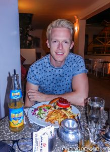 Me trying a delicious Camel burger in Marrakech