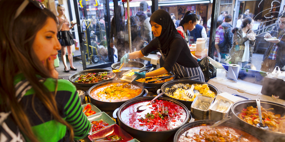 Busy food stalls, Brick Lane, London. 10 Reasons why we think London is Awesome.