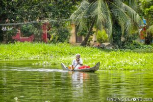 Local man passing buy. Must See Places in Kerala - Kerala Backwaters.