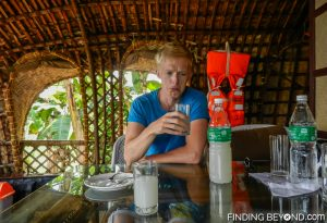 Darren not quite liking Keralan homemade coconut toddy. Must See Places in Kerala - Kerala Backwaters.