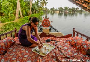 Morning tea on deck. Must See Places in Kerala - Kerala Backwaters.