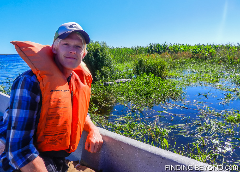 Posing with resident caiman at Argentina's Ibera Wetlands. Our Ibera Wetlands Argentina Wildlife Adventure.