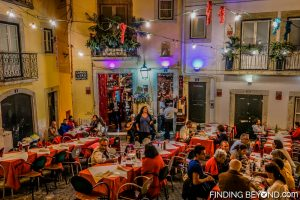 Fado artist entertaining dinners. Things to do in Alfama District - Lisbon Old Town.