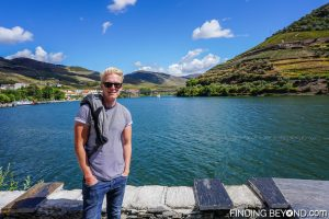 Me on the riverside in Pinhao. Our guide to the Douro Valley, Portugal.