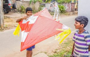 Local kids with their homemade kite. Negombo, Sri Lanka. Things to do in Negombo Beach? Don't Expect Much.