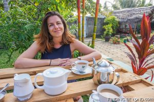 Shelley enjoying tea in the garden of D-Villa Negombo. Things to do in Negombo Beach? Don't Expect Much.