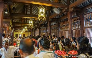 Buddhists queing to give their offerings. Kandy, Sri Lanka. Top 5 Things to do in Kandy City in One Day.