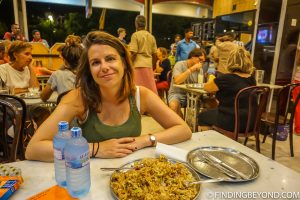 Shelley with a large chicken kottu. Kandy, Sri Lanka. Top 5 Things to do in Kandy City in One Day.