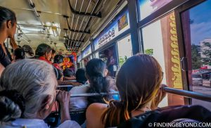 Shelley looking out of her window seat on the crowded Negombo to Kandy bus. Top 5 Things to do in Kandy City in One Day.