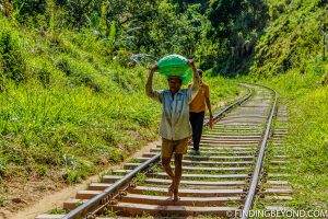 Who needs a train when you can carry heavy loads yourself on your head and barefoot. Hiking in Sri Lanka is a must when visiting the island and Ella Rock is a highland highlight. We documented our climb to the top with some wonderful photos.