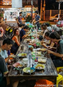 Waiting for soup in Chiang Mai, Thailand. Tips on How to Save Money for Travel.