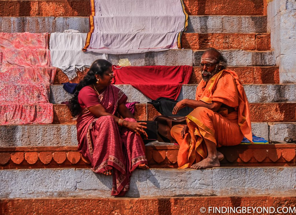 Indian photo of monk chatting with local in Varanasi