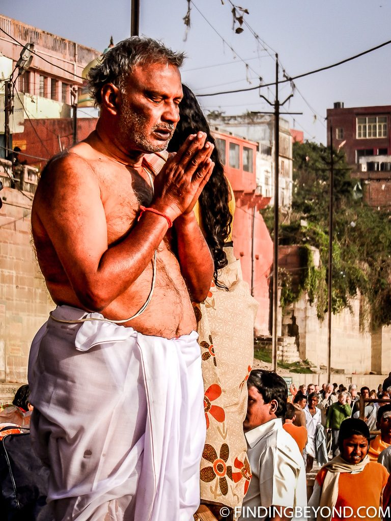 Indian photo of man in prayer in Varanasi