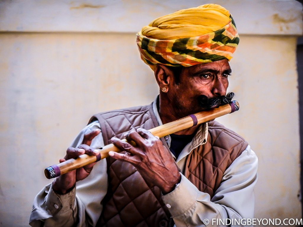Indian photo of flute player in Delhi