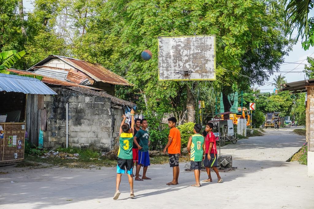 Kids playing basketball in Santa Fe on Bantayan Island, Cebu, Philippines