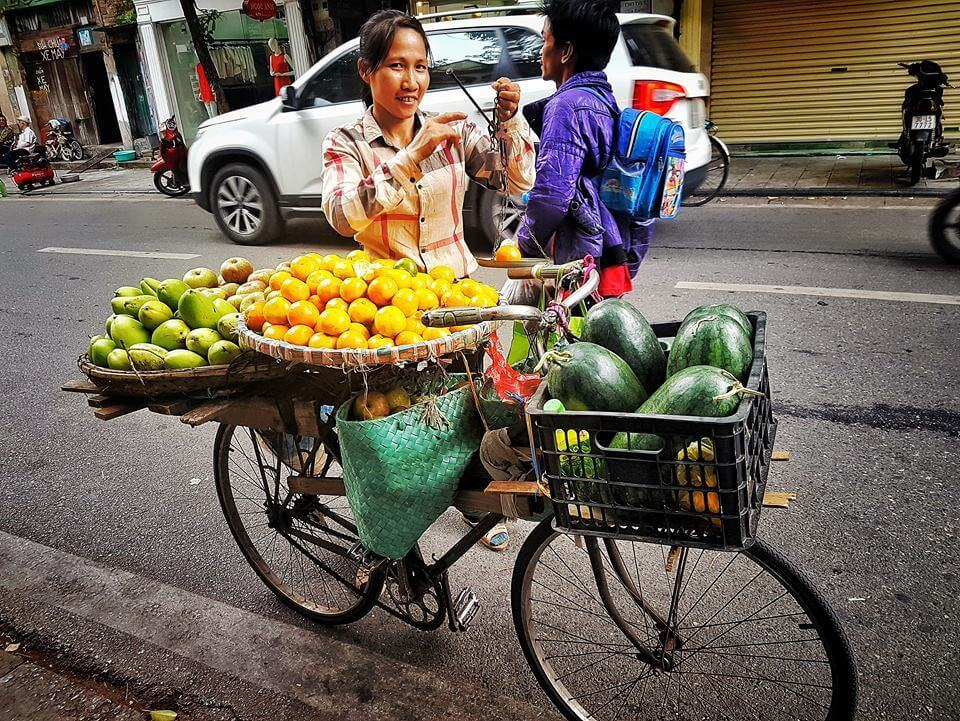living in vietnam as a digital nomad hanoi fruit seller