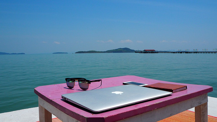 digital nomad tools laptop sea