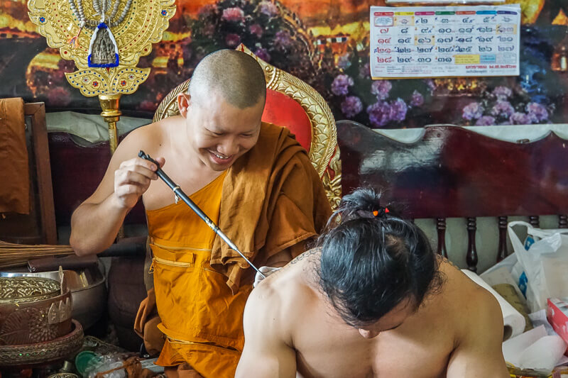 man getting sak yant tattoo in chiang mai