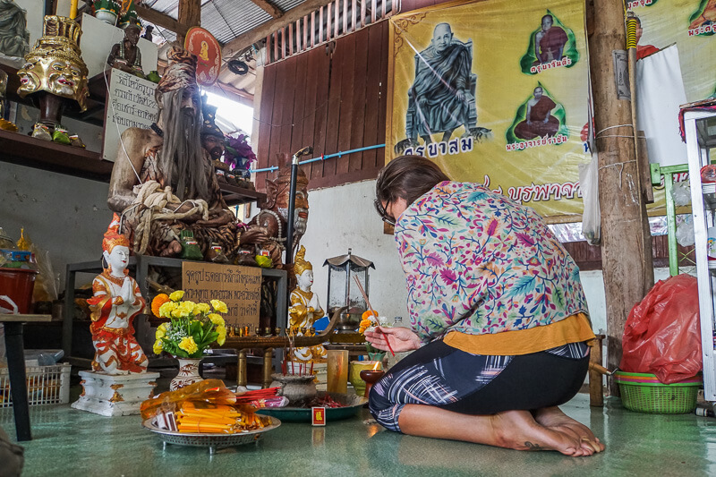 praying before getting my sak yant tattoo chiang mai