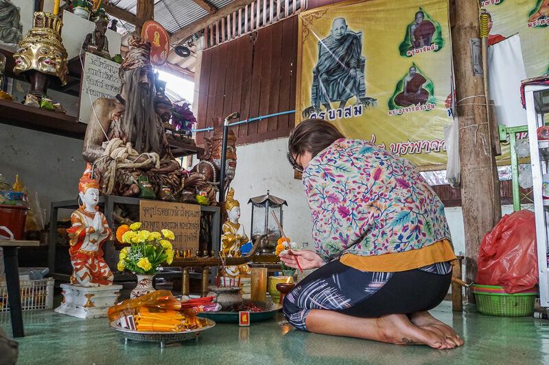praying before getting my sak yant tattoo chiang mai