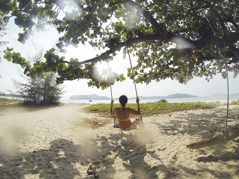 digital nomad skills girl on beach swing