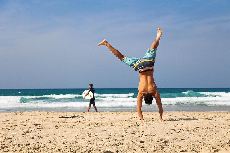 digital nomad skills beach hand stand